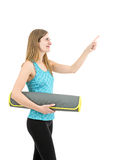 Young friendly fitness woman pointing to copy space Stock Photography