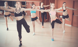 Young friendly girls performing modern dance in fitness studio royalty free stock images