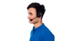 Young friendly guy wearing headset Royalty Free Stock Image