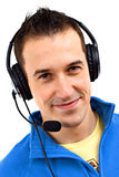 Young friendly man. With headset on white background Stock Photo