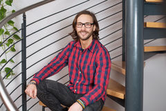 Young friendly man in checkered shirt Royalty Free Stock Photo