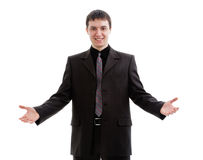 The young, friendly, a man in a suit, welcomed. The young, friendly, a man in a suit, welcomed, isolated on a white background Stock Photo