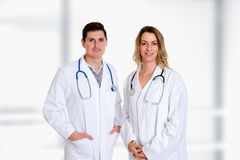 Young friendly medical team with book in lab coat Stock Photos