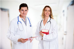 Young friendly medical team with book in lab coat Royalty Free Stock Photography