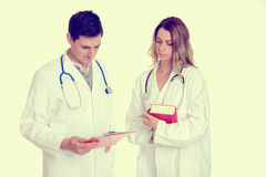 Young friendly medical team with book in lab coat Stock Image