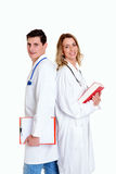 Young friendly medical team with book in lab coat Stock Images