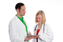 Young friendly medical team in lab coat. In front of white background Royalty Free Stock Photography