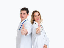 Young friendly medical team with thumb up Royalty Free Stock Images