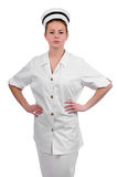 Young friendly nurse with both hands on hips Stock Photos