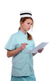 Young friendly nurse with a chart and a pen Stock Images