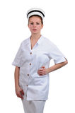 Young friendly nurse with a hand on a hip Royalty Free Stock Images