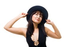 Young friendly woman smile and hold big hat Stock Photos