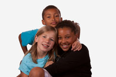 Young friends. Portrait of three children, two girls and one boy of mixed ethnicity Stock Photo