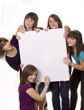 Young friends behind a billboard Royalty Free Stock Photography
