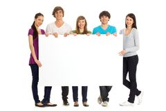Young friends with a billboard Stock Photo