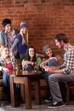 Young friends in cafe. Smiling Stock Image