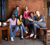 Young friends in cafe Royalty Free Stock Photos