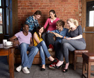 Young friends in cafe Royalty Free Stock Photo