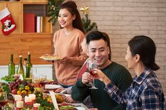 Young friends celebrating Christmas royalty free stock image