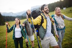 Young friends on a country walk. Group of people hiking through countryside royalty free stock photography