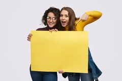 Young friends demonstrating empty banner stock images