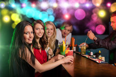 Young friends drinking cocktails together at party Royalty Free Stock Photos