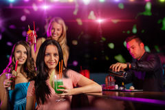Young friends drinking cocktails together at party Stock Photography