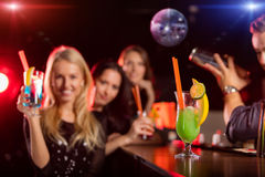 Young friends drinking cocktails together at party Stock Images