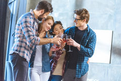 Young friends drinking wine Stock Photography
