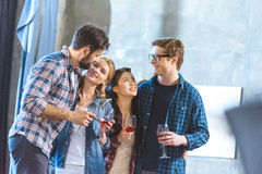 Young friends drinking wine Royalty Free Stock Images