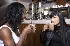 Young Friends enjoy Coffee at a Coffeeshop Stock Images