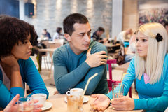 Young friends enjoy in coffee Royalty Free Stock Images