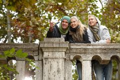 Young friends enjoying autumn in park Royalty Free Stock Image