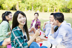 young friends enjoying  healthy picnic Stock Photography