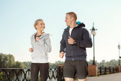 Young friends enjoying a run outdoors Stock Image
