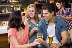 Young friends having a drink together Stock Images
