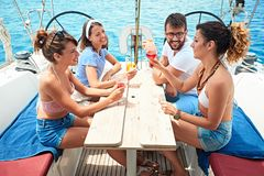 Friends having drinks on yacht - Summer holidays stock photo
