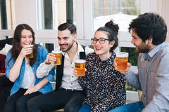 Young friends having fun in a bar Stock Image