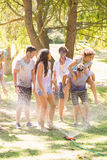 Young friends having fun with hose in the park Stock Photos
