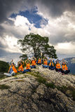 Young friends having fun on the picnic on the island of Norway Royalty Free Stock Photos