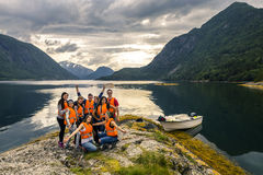 Young friends having fun on the picnic on the island of Norway Royalty Free Stock Images