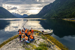 Young friends having fun on the picnic on the island of Norway Stock Photos