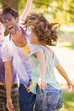 Young friends having fun with powder paint Royalty Free Stock Images