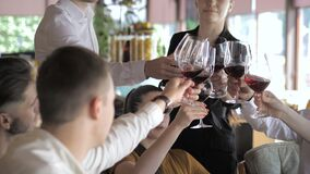 Young friends having fun in the restaurant drinking red wine. Youth friendship concept