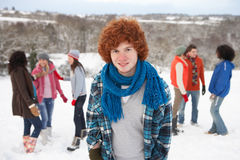 Young Friends Having Fun In Snow Royalty Free Stock Images