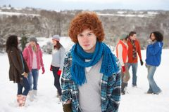 Young Friends Having Fun In Snowy Landscape Royalty Free Stock Photos