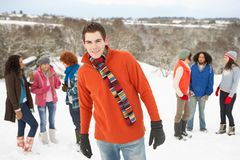 Young Friends Having Fun In Snowy Landscape Stock Photos