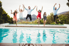 Young friends having fun at swimming pool Stock Images