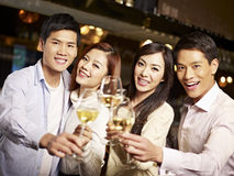 Young friends having good time in pub. Young asian friends couples enjoying party in pub Stock Images