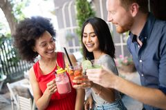 Young friends having a great time together. Group of people talking and smiling. stock photography